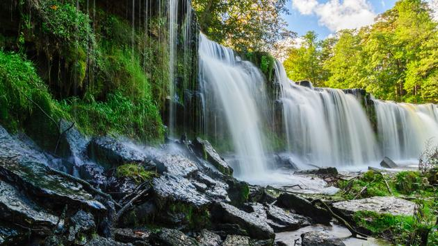 Water cascading down from Keila-Joa waterfall, Estonia (photo via leskas / iStock / Getty Images Plus)