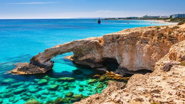 Beautiful natural rock arch near of Ayia Napa, Cavo Greco and Protaras on Cyprus island, Mediterranean Sea. (Photo via Oleg_P / iStock / Getty Images Plus )
