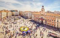 The Puerta del Sol square is the main public square in the city of Madrid, Spain. In the middle of the square is located the office of the President of the Community of Madrid. (photo via LucVi / iStock / Getty Images Plus)