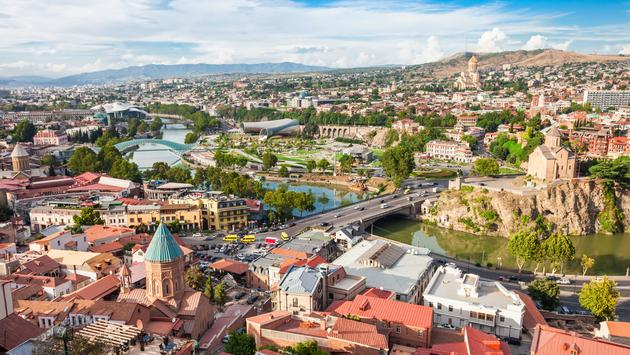 Tbilisi city center aerial view from Narikala Fortress, Georgia (photo via saiko3p/iStock/Getty Images Plus)