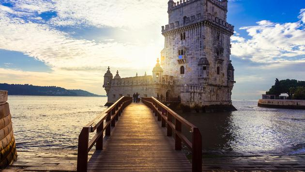 Torre de Belem over sunset - famous landmark of Lisbon , Portugal (Photo via Freeartist / iStock / Getty Images Plus)