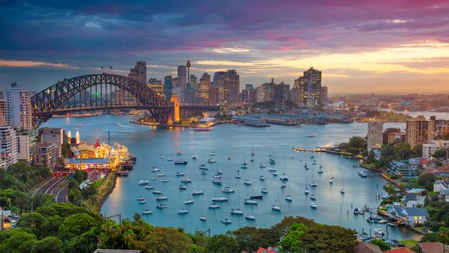 Cityscape image of Sydney, Australia with Harbour Bridge and Sydney skyline during sunset. (photo via RudyBalasko / iStock / Getty Images Plus)