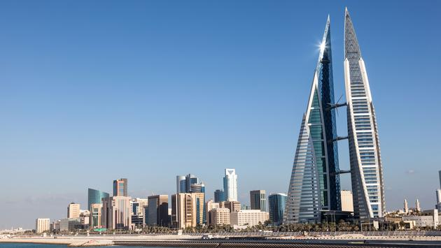 World Trade Center skyscraper and skyline of Manama City, Kingdom of Bahrain, Middle East (photo via typhoonski/iStock/Getty Images Plus)