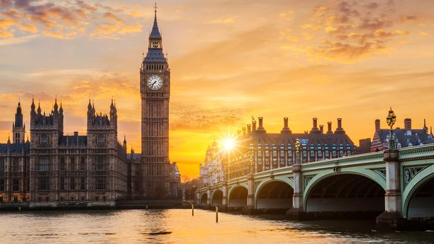 Big Ben and Westminster Bridge at sunset, London, UK (Photo via vwalakte / iStock / Getty Images Plus)