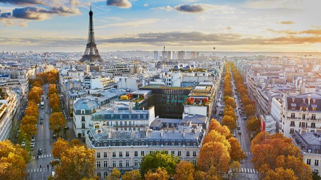 Aerial panoramic cityscape view of Paris, France with the Eiffel tower on a fall day (encrier / iStock / Getty Images Plus)