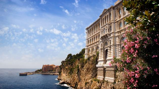 View from Monaco bay with Museum of Oceanology (photo via Maximastudio / iStock / Getty Images Plus)