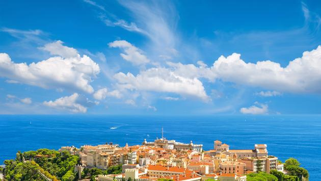 View of Monaco with Prince's Palace and Oceanographic Museum. French riviera. Mediterranean Sea landscape with beautiful blue sky (photo via LiliGraphie / iStock / Getty Images Plus)