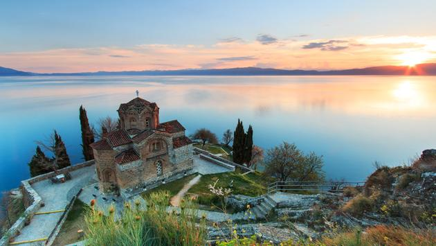 Sveti (Saint) Jovan Kaneo Church on Lake Ohrid, Macedonia at sunset (photo via outcast85 / iStock / Getty Images Plus)