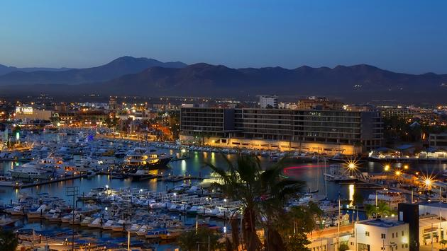 Los Cabos (Cabo San Lucas), Mexico night view of city and marina (Photo via  ggutarin / iStock / Getty Images Plus)