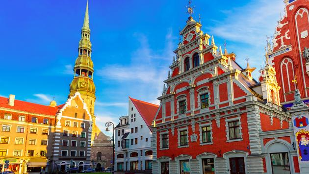 City Hall Square with House of the Blackheads and Saint Peter church in Old Town of Riga in the evening, Latvia (Photo via KavalenkavaVolha / iStock / Getty Images Plus)